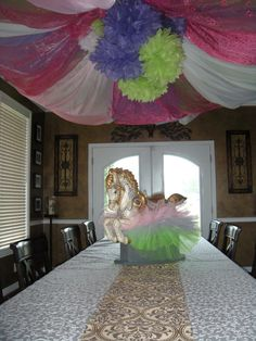 used and old hula hoop, repurposed and attached old sheer curtains .held it all up with fishing string...... perfect touch to Lynee's baby shower... DD creation...