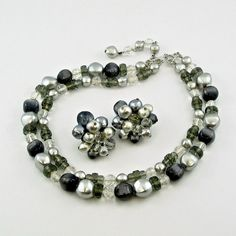 Having a variety of sizes of smoky crystals that are faceted and rounded (typical of Miriam Haskell designs), this demi parure is incredibly classy.