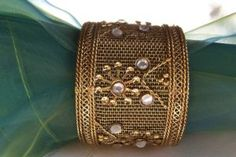We sell 45 different styles and colors of napkin rings. We stock 100's per style for large events or buy a single set of 6 for at-home entertaining. These lovely gold filigree napkin rings are constructed of a sturdy gold mesh set with clear rhinestones. he ring measurements are 1.5 inches wide inside the ring, almost 2 inches wide including the beads on the outside of the ring, and 1.5 inches tall.