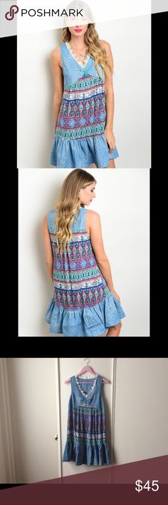 Boutique Fashion Denim Lace Boho Tunic Dress Lightweight denim style dress with lace trim, and boho pattern. Ruffle bottom. I have 1 Medium and 2 Large. New with Boutique Tag. 65% Cotton, 35% Polyester. Dresses