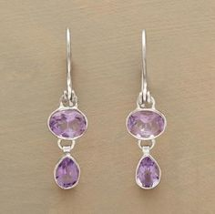"""An elegant symmetry in amethyst, oval atop teardrop, in handcrafted sterling silver earrings made to dance in the light. 1-3/8""""L."""