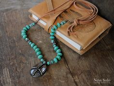 Long leather and turquoise beaded necklace - peace sign crystal pendant - Czech glass beads - bohemian jewelry hippie chic festival style by NessSolo on Etsy https://www.etsy.com/listing/495569431/long-leather-and-turquoise-beaded