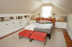 Spacious master bedroom in finished attic! Great use of knee walls for storage!