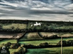 The Osmington White Horse is a hill figure sculpted in 1808 into the limestone of Osmington Hill, north of Weymouth in Dorset, UK. The figure is of King George III, who regularly visited Weymouth. Beautiful Places In The World, Most Beautiful, White Horses, King George, Landscape Photos, Countryside, Golf Courses, Landscapes, Park