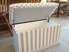 Upholster the lid of a trunk in navy and white striped taffeta-type material