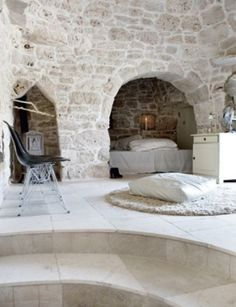 cave living - I actually really like the idea of a small sleeping area off of the much larger bathroom area.  A lot.