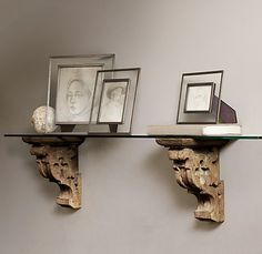 mantel idea: gothic carved wood corbels to support a slab of rough-hewn marble
