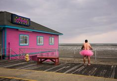 When his wife was diagnosed with breast cancer, loving husband and photographer Bob Carey put on a pink tutu and posed for the camera in an effort to raise both awareness and money for breast cancer research. The