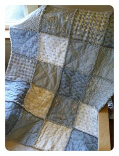 "Baby Boy Rag Quilt - DIY! - Quilting In The Rain. Uses layer cakes on both sides of the ""sandwich"""