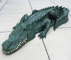 Paper maché alligator — waterproofing and painting