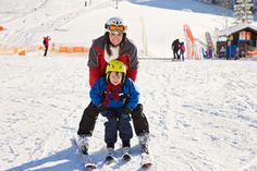 A mother and her young son going skiing