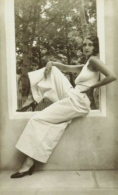 These wide-leg, very long pants were popular in the 1930's as loungewear or beachwear.  Palazzo pants are so glamorous and very comfortable!  The gorgeous Romanian beauty Renee Perle looking fabulous in these creamy  palazzo pants.
