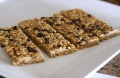 no bake homemade chewy granola bars that use real ingredients like honey, coconut oil, oats, ground flax seeds, and crunchy peanut butter! k...