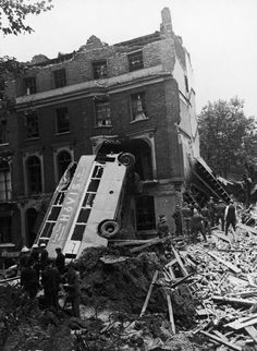The wreckage of a bus, which was blasted against a house in London during The Blitz, 9th September 1940