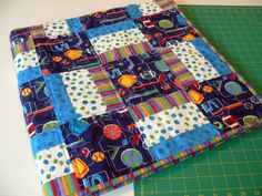 """asimplelife Quilts: Project Linus.  """"Sports Kid"""" will be donated to Project Linus and is made using the free Warm Wishes pattern found at Quiltmaker.com. If you are ever looking for a quick, easy and fun to make pattern Warm Wishes should be at the top of your list."""