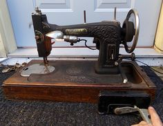 Circa 1927 (I think it was rewired) motorized White Sewing Machine I fixed up (cleaned/oiled; some before pics, mostly all after). It works (photo one is of it running and lit by its lamp). Found it for a good price at a thrift store today and hope to make a profit. This one I believe was meant to be a portable one (judging by the wooden box it sets in, which wouldn't connect to a desk-type machine like my others.
