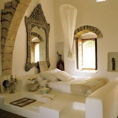 Peaceful yet exotic alcove to sleep in. Now if that window has a view of the sea... perfect.