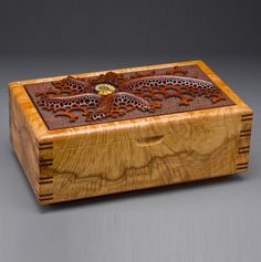 """Mark Doolittle: """"Maple Jewelry Box"""" (Closed) 4""""h x 11""""w x 6""""d. Maple Burl side with African Padauk top. George Post, photography."""