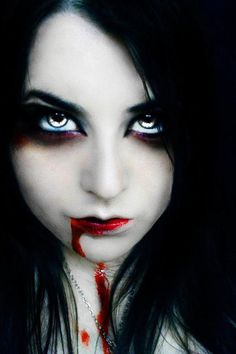 Sexy vampire babe with gorgeous undead eyes.