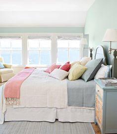 Pretty summer house colours work to perfection in this bedroom