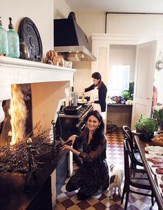 """""""You just need a simple grilling rack and simple vine branches that have been pruned and dried,"""" says food blogger Mimi Thorisson on her kitchen's open-fire fireplace."""