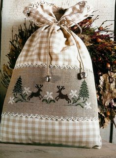 Reindeers, Flowers and Trees • 1/3 Design used as a focal point on a drawstring bag
