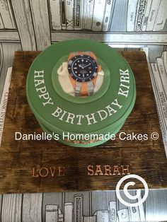 Rolex theme cake by Danielle's homemade cakes #cake #rolex #watchcake #gold #silver #danielleshomemadecakes #man #classy #sophisticated #wood #decoratedboard
