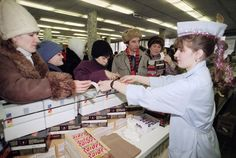 Soviet shoppers waited more than two hours to reach the counter to buy American brands of Chocolate candy bars, such as Snickers, Mounds, and Milky Way, in downtown Moscow on January 4, 1991.