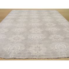 Enjoy the quiet elegance of this classic rug re-invented in a monochrome palette. This luxurious floor covering features a stylish traditional oriental pattern in rich colors like grey and ivory. Hand