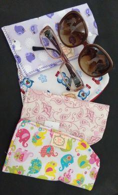 https://www.facebook.com/vickartes  Capinha multi uso: óculos de grau; óculos de sol; celular...