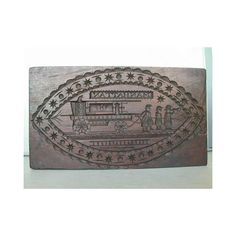 Rectangular wooden (possibly mahogany) cake board carved on one side with image of three firemen pulling Manhattan fire engine number 8 within a swag and star oval frame; reverse carved with image of three firemen pulling Superior fire engine number 17 within an oval foliate frame.