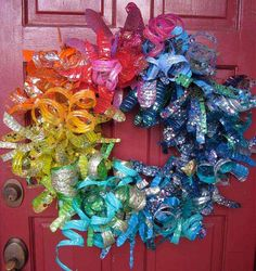 Dale Wayne's Plastic Bottle Flower Wreath at Dollar Store Crafts -- Recycled, festive, colorful AND glitter-y! My kinda flower wreath for sure! Plastic Bottle Flowers, Plastic Bottle Crafts, Recycle Plastic Bottles, Recycled Bottles, Water Bottle Crafts, Plastic Art, Wreath Crafts, Fun Crafts, Wreath Ideas