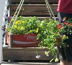 Repurposed vintage Coke crates into hanginv baskets
