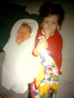 baby Harry Styles, with older sister Gemma Styles.