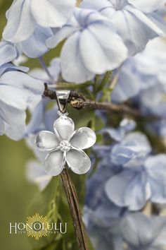 """Queen Plumeria Silver Pendant with high polish petals. Clear CZ stone in center. 20mm (approx. 13/16""""). 18"""" box chain included."""