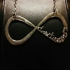 New silver Direction Infinity necklace New silver Direction Infinity necklace. Never been worn. Jewelry Necklaces