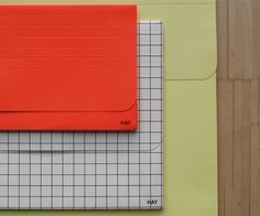 Hay, 3 envelopes: coral, squared and yellow. by Tas-ka