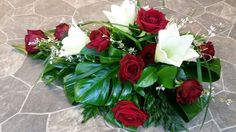 Funeral spray with roses and lilies.