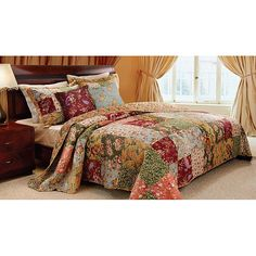 Vibrant floral and paisley prints highlight this oversized king-size quilt set. Constructed of soft cotton, the quilt reverses from a lovely patchwork to a vintage-inspired floral back.