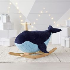 Catch some playroom waves on our Whale Rocker. It has a plush exterior for a soft seat, and a sturdy wooden handle and frame for a smooth ride. Embroidered spots and a blowhole give it a richly detailed look, from fins to tail. Sea Nursery, Whale Nursery, Nautical Nursery Decor, Nursery Lamps, Sailboat Nursery, Ocean Themed Nursery, Coastal Nursery, Crate And Barrel, Baby Boy Rooms