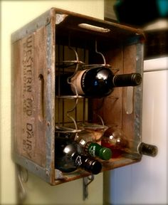 Vintage dairy crate w/ the rack intact becomes super fun wine storage when turned on its side or mounted to the wall.