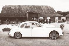 Classic wedding Jaguar at Stockbridge Farm Barn by one thousand words wedding photographers in Dorset and Hampshire www.onethousandwords.co.uk