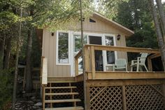 a beautiful newly built waterfront cottage nestled in the gatineau