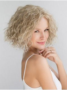 The perfect summer look! Curly, fun, and short!