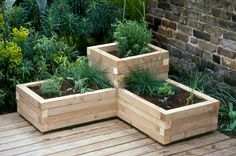 beginning and experienced gardeners love raised garden beds. Here are 30 cool ideas for raised garden beds, from the practical to the extraordinary. 30 Raised Garden Bed Ideas via Recycled Planters, Deck Planters, Garden Planter Boxes, Wooden Garden Planters, Wood Planter Box, Indoor Planters, Planter Ideas, Deck With Planter Boxes, Vegetable Planter Boxes