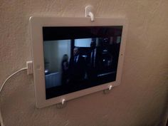Ipad wall holder with 3m wall hooks. This whole site is like McGyver on steroids.