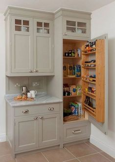 25 Smart Small Pantry Ideas to Maximize Your Kitchen Storage Space The modern kitchen is a space that demands plenty in terms of both ergonomics and aesthetics. You need to combine storage with smart displays and the Traditional Kitchen Cabinets, Kitchen Pantry Cabinets, Kitchen Cabinet Storage, Storage Cabinets, Small Pantry Cabinet, Pantry Doors, Corner Cabinets, Traditional Kitchens, Organized Kitchen