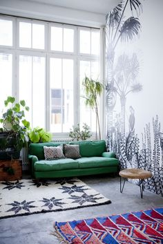 Unique living room design featuring an emerald green sofa, patterned rugs, and a large black and white tropical wall mural (wallpaper) - Modern Global Decor & Bohemian Decorating Ideas - Wallpaper By Bien Fait + Parisian Home Of Cécile Figuette Decor, Green Sofa, House Design, Home And Living, Loft Spaces, Home Decor, House Interior, Room Decor, Home Deco