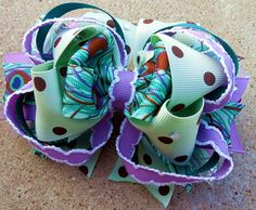 """Our hair bows are handmade with perfection and over the top quality ribbon. We take the time to make every hair bow special, that is why we are """"Knot Your Average Bow"""" www.facebook.com/messyjessieshairbows"""