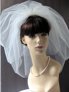 "Illusion Tulle Bubble Bridal Veil 21"" 2- Layer, shoulder length bubble veil. $60.95, via Etsy."